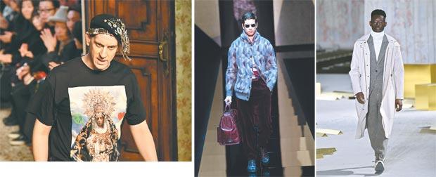 PERSONAGEM: Designer norte-americano Jeremy Scott fechou o desfile da Moschino em Milão   CASACOS LONGOS: Na foto ao lado, modelo apresenta criação de Giorgio Armani. Na outra foto mais à direita, a interpretação da moda por Ermenegildo Zegna Zegna (AFP PHOTO / Alberto PIZZOLI)